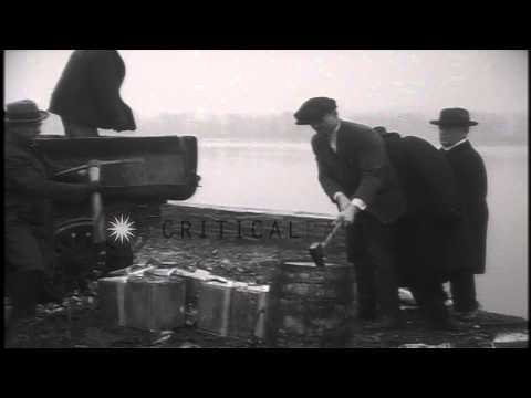 Bootleg whiskey and liquor is siezed and dumped during prohibition in the United ...HD Stock Footage