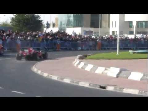 Ferrari Formula 1 car in Qatar Accompanied by another Ferrari Car