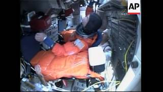 Astronauts put their suits on ahead of launch