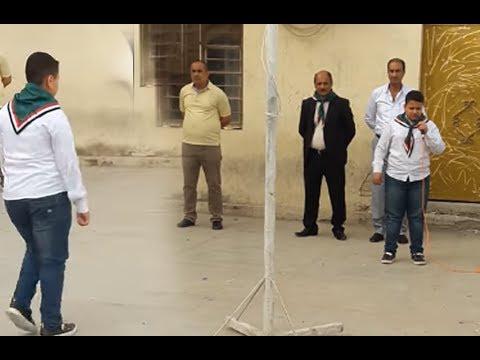 الرادود مسلم الكعبي في المدرسة يقرأ قصيدة ايها العلم بصوت و اسلوب جميل جدا