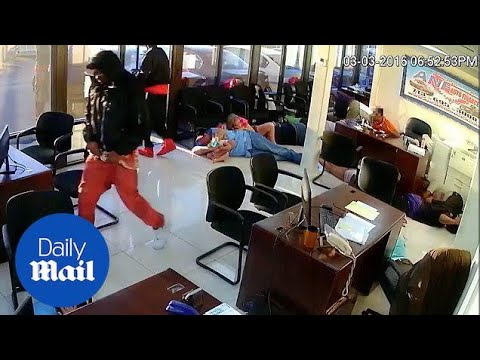 Police release video of armed robbery in Houston finance store - Daily Mail