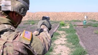 Soldiers Qualifying on the Beretta M9 Pistol and MK-19 Grenade Launcher