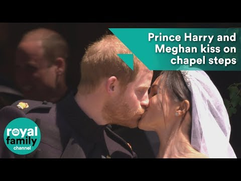 Prince Harry and Meghan kiss on the steps of St George's Chapel after wedding ceremony