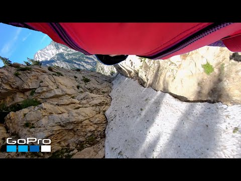 It Came From The Web - Wingsuit Pilot Flies Through a Narrow Pass in the Utah Mountains (Video)