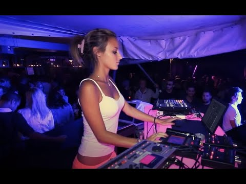 Female DJ using the YOU.DJ app in the club
