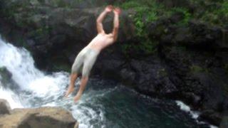Waterfall cliff jumping in Hawaii
