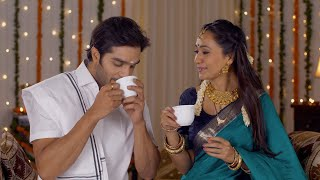 South Indian couple dressed in a traditional dress and drinking a hot tea together - Lifestyle