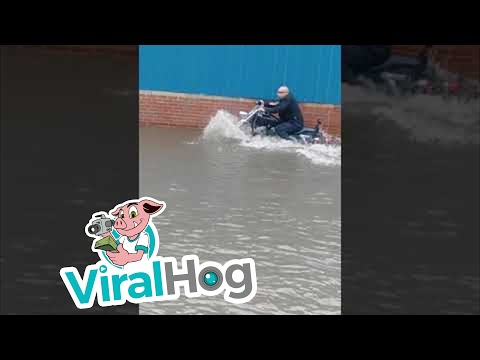 Gizmo - Guy Drives Motorcycle Through Flood Waters