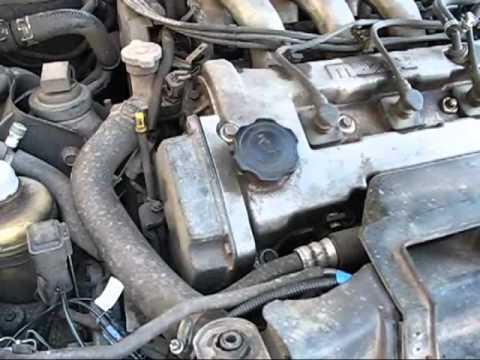 звук от двигателя в районе грм при средних оборотах mazda 323