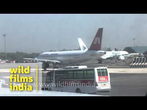 Jet Airways and Air India planes wait on apron of Delhi Airport