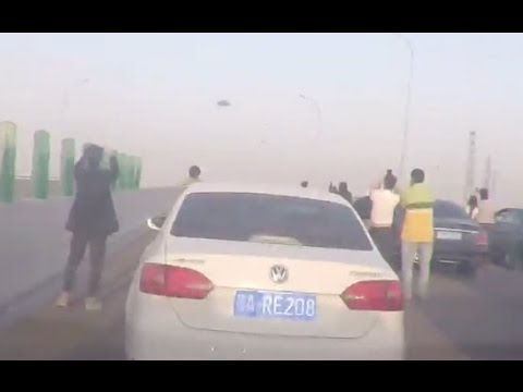 UFO Over China Causes Traffic On Freeway To Come To A Stop