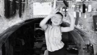 Cheerful boy dancing in Aleppo, Syria
