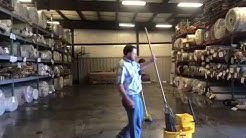 The Process of Cutting an Extra Wide Roll of Carpet