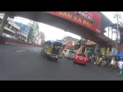 American guy rides bike through streets of Manila, Philippines