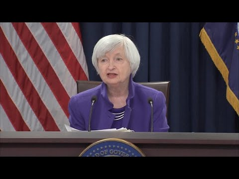 Federal Reserve hikes interest rates, raises forecast