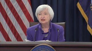 Federal Reserve hikes interest rates, raises forecast