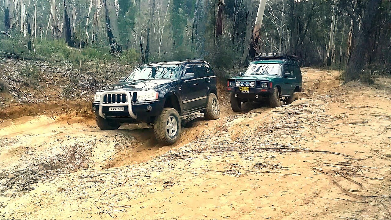 jeep grand cherokee vs land rover discovery youtube. Black Bedroom Furniture Sets. Home Design Ideas