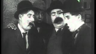 Charlie Chaplin in GIORNO DI PAGA