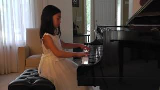 Piano Concerto No. 23 In A Major 1st Movement K. 488 by Mozart - Tasha Piyabongkarn (Age 9)