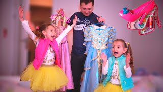 Папа и девочки играют и наряжаются на бал