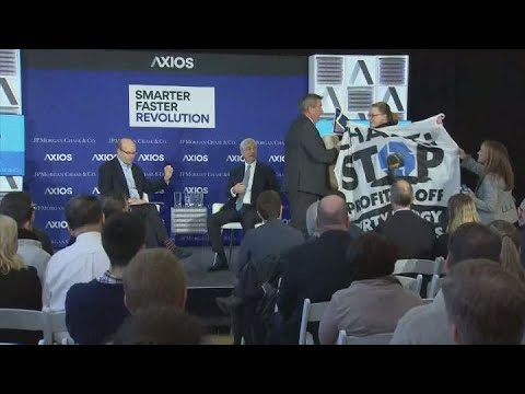 JP Morgan CEO Jamie Dimon confronted by protesters at Axios event