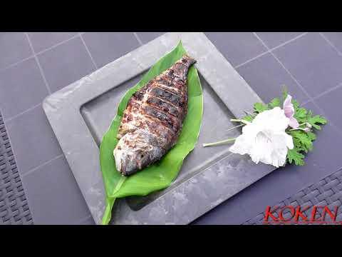 Vis van de barbecue (Dorade, Wijting gewikkeld in bananenblad, Mul, Kuit)