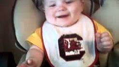 Gamecock Baby Laughing at Napkin!