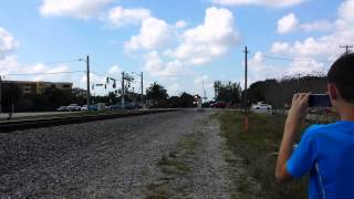 GUY RUNS IN FRONT OF FEC TRAIN ALMOST GET HIT , Breaks Gate