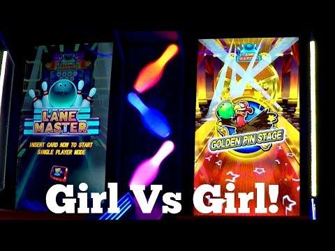 girl-versus-girl-playing-lane-master-mini-bowling-arcade-game