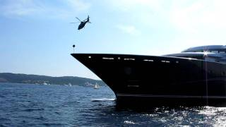 Helicopter taking off from a super yacht in Saint Tropez beaches (Pampelone)