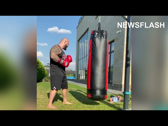 Rapper Hits Punch Bag And Knocks Over Toddler Son