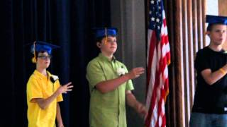 Zachary using American Sign Language for song during 6th grade graduation.