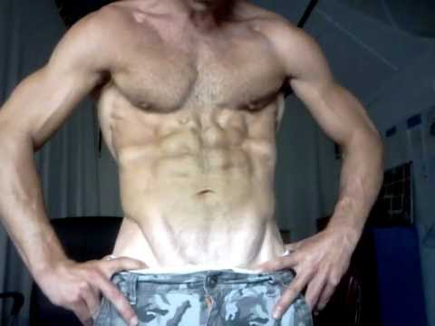 Muscle flexing sixpack abs & upper body shirtless
