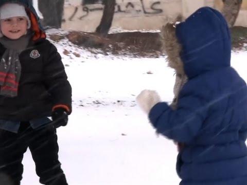 Raw: Children Play in Snow in Embattled Aleppo