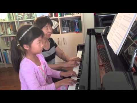 Angela Lin, 7 yr old, enjoys playing the duets with Xiaole Li and improvising her own music.