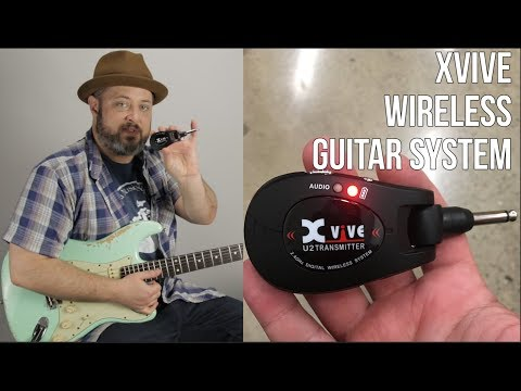Wireless Guitar System - Xvive - Play Guitar Without the Mucky Muck!