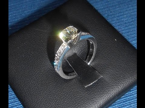 Handmade gold four prong Solitaire Engagement Ring. https://pixlypro.com/ywDGmxH