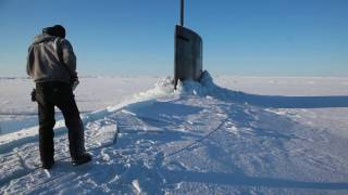 us navy submarine surfaces in the arctic ocean