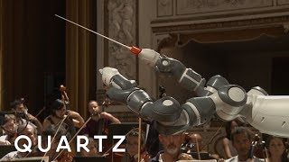 A robot conducts an orchestra