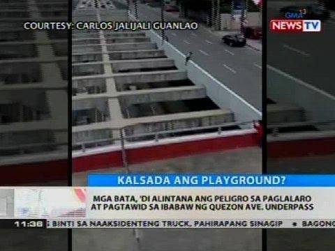 Mga bata, 'di alintana ang peligro sa paglalaro at pagtawid sa ibabaw ng Quezon Ave. underpass