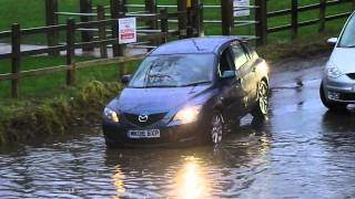 vehicles crossing a flooded ford 2016 - river crossing