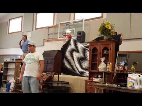 Leon Coblentz, auctioneer at Hartville Christian School Sale - 2015