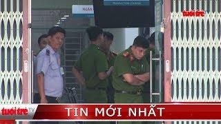 Bị bảo vệ chống cự, 2 thanh niên cướp ngân hàng tháo chạy