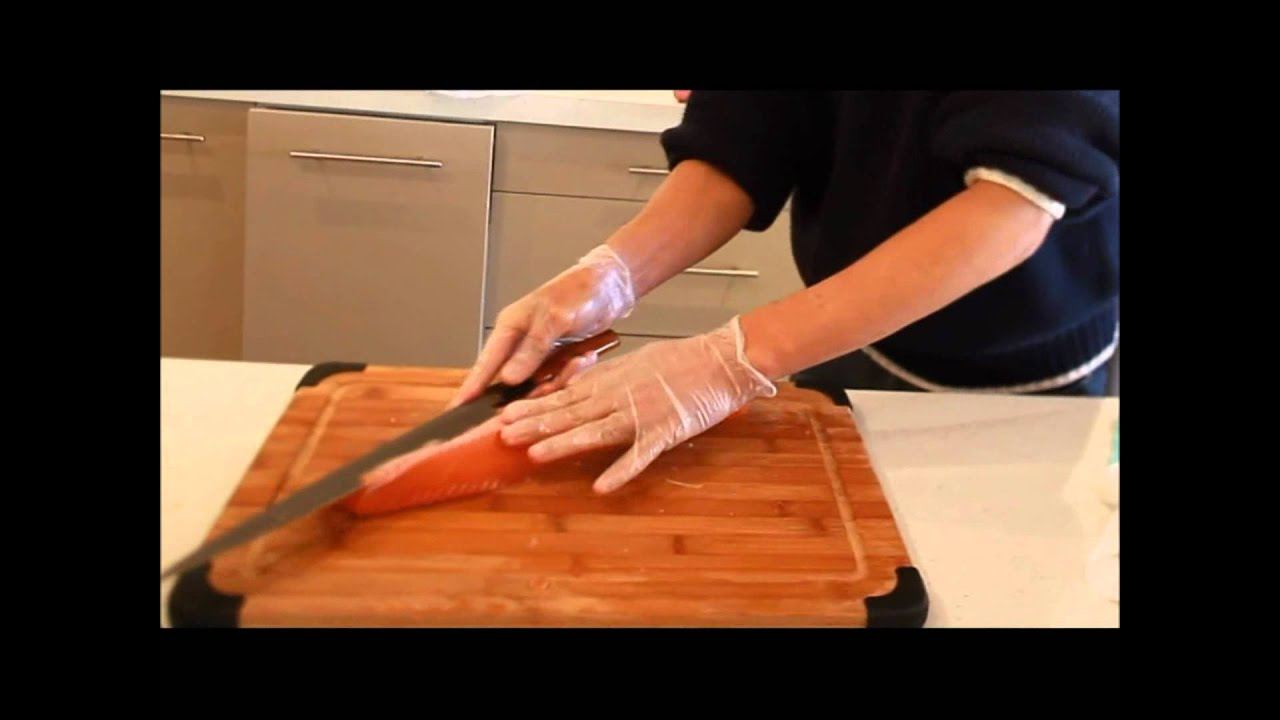 Professional Japanese Chef Preparing Sashimi