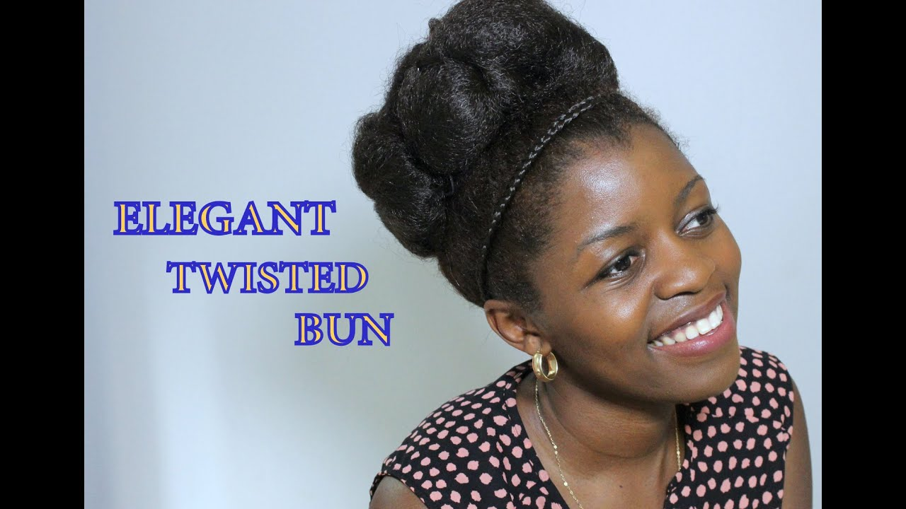 Elegant Twisted High Bun Natural Hair Wedding Hairstyle