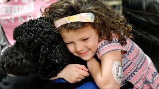 'Now she gets to be the kid with the cool dog,' mother of daughter with diabetes says of alert dog