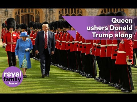 Queen ushers Donald Trump along as he inspects Guards