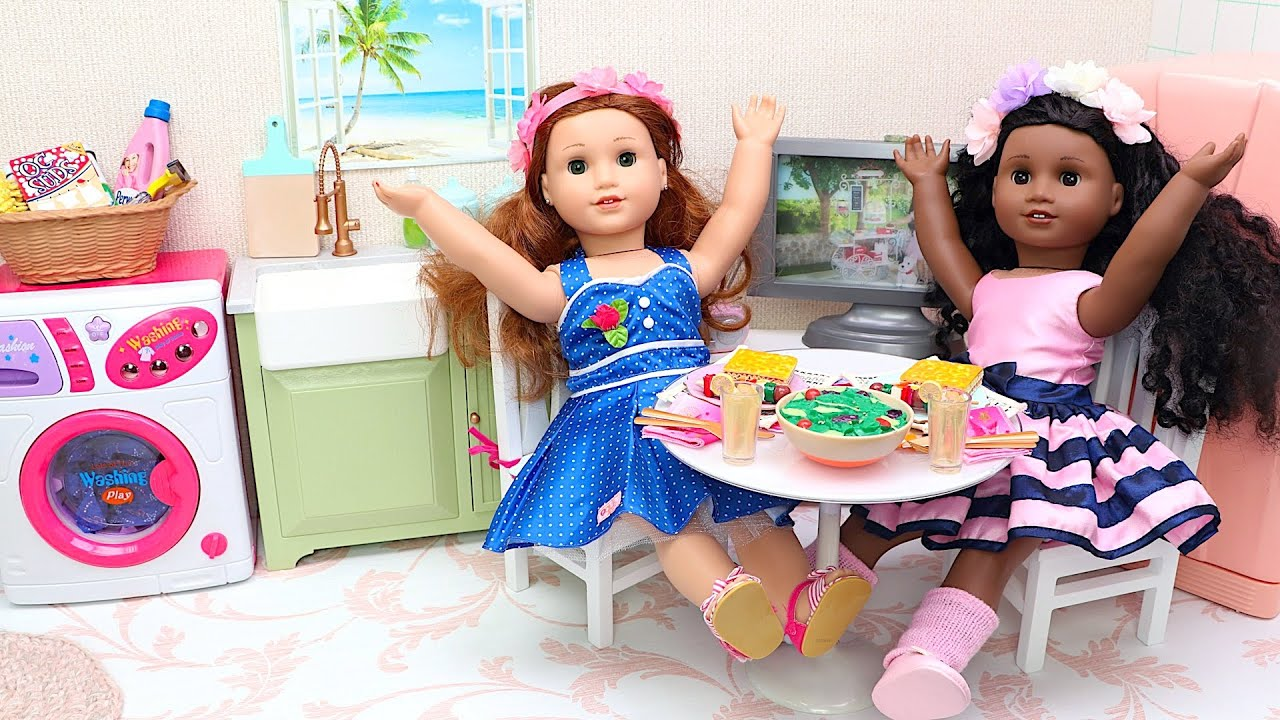 Doll friends pretend play with kitchen toys in dollhouse
