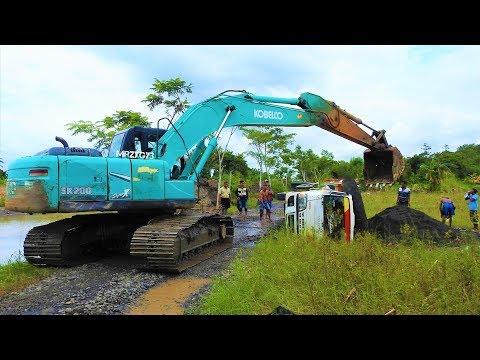 Overloaded Tipper Dump Truck Crash Recovery By Excavator Kobelco SK200