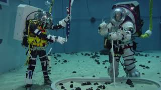 Astronauts Test Tools Spacesuits Facilities in Preparation for Moonwalks